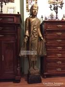 Antik Buddha szobor, ember nagyságú.