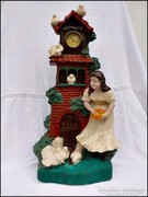 Antik vásári órás szobor  - Galambokat etető lány