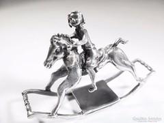 Ezüst, hintalovon ülő kislány( Szeg-Bi19243)