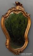 Barokk stílusú műanyag keretű tükör.