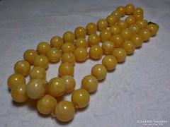 Hosszú műanyag sárga  nyaklánc
