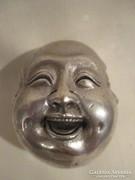 4 arcú Budha fej.
